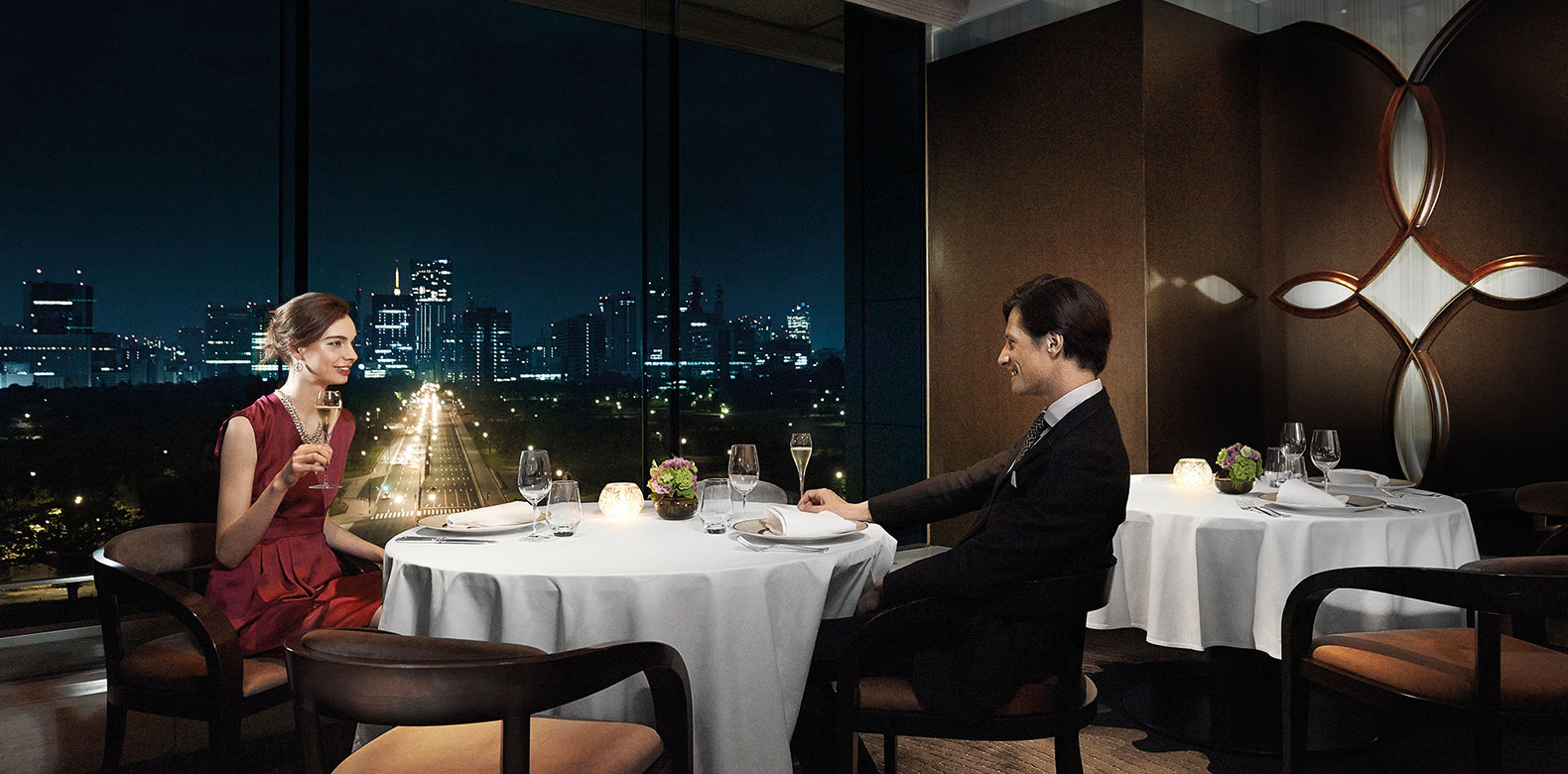 Man dining in Crown Restaurant at the Palace Hotel, exquisite fine dining Tokyo